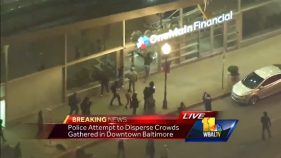 Police Attempt to Disperse Crowds Gathered in Downtown Baltimore