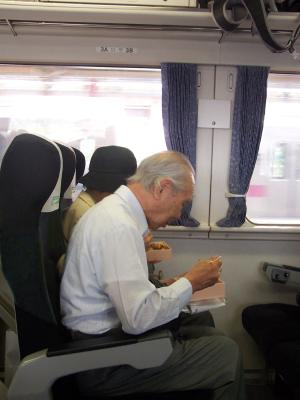 Elderly man on a train